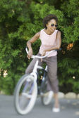 African American woman on bicycle — Stockfoto