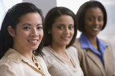 Multi-ethnic businesswomen sitting in row — Stock Photo