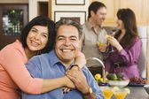 Middle-aged Hispanic couple hugging at party — Stock Photo