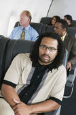 Portrait of man on airplane — Stock Photo