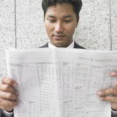 Close up of businessman reading newspaper — Stock Photo