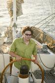 High angle view of man steering sailboat — Stock Photo