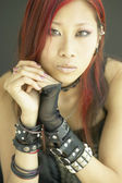 Portrait of young woman with leather bracelets — Stock Photo