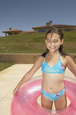 Young girl wearing an inner tube — Stock Photo