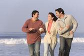 Hispanic friends walking on beach — Stock Photo