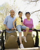 Grandparents and granddaughter in jeep — Stock Photo