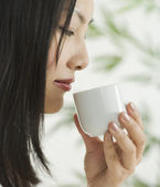 Profile of woman drinking tea — Stock Photo