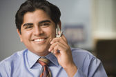 Businessman smiling for the camera — Stock Photo