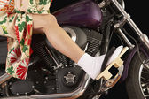 Asian woman in ethnic clothes driving a motorcycle — Stock Photo