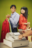 Couple buying clothes — Stock Photo