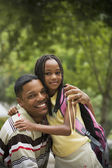 Portrait of African father and daughter hugging — Stock Photo