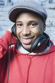 Teenage boy wearing headphones — Stock Photo