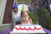 Young boy and girl at birthday party — Stok fotoğraf