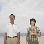 Couple standing at beach — Stock Photo