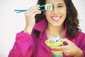 Young woman holding chopsticks — Stock Photo