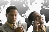 African American businessmen using cell phones — Stock Photo