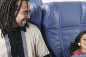 Father with young daughter on airplane — Stock Photo