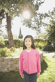 Young Asian girl standing in the sunlight — Stock Photo