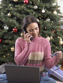 Woman ordering gifts with credit card — Stock Photo