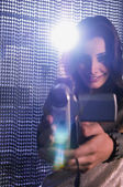 Middle Eastern woman using video camera — Stock Photo