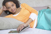 Portrait of woman reading book — Stock Photo
