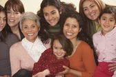 Female Hispanic family members smiling — Stock Photo