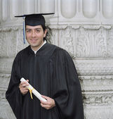 Young graduate smiling for the camera — Stock Photo