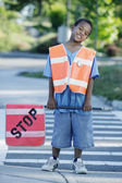 Portrait of boy on cross walk duty — Stock Photo