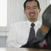 Asian businessman smiling — Stock Photo