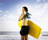 Portrait of woman with body board at beach — Stock Photo