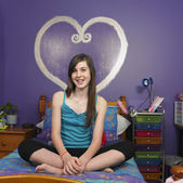Portrait of teenaged girl in bedroom — Stock Photo
