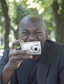 African man using digital camera — Stock Photo
