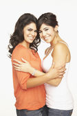Portrait of Hispanic adult sisters hugging — Stock Photo