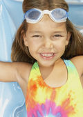 Young girl smiling for the camera — Stock Photo
