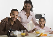Portrait of family at breakfast table — Stock Photo