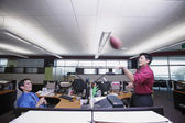 Two businessmen playing catch with football — Stock Photo