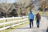 Young men walking on rural road — Stock Photo
