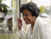 Senior African businesswoman window shopping — Stock Photo