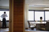 Businessmen working in separate offices — Stock Photo