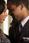 Close up of African couple smiling at each other — Stock Photo