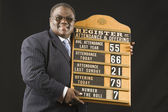 African man holding hymn board — Stock Photo