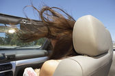 Young woman's hair being blown by wind — 图库照片
