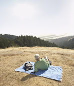 Senior man relaxing on a blanket outdoors — Stock Photo