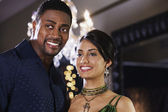 Close up of multi-ethnic couple smiling — Stock Photo