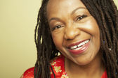 Close up of middle-aged African woman smiling — Stock Photo