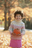 Portrait of girl holding pumpkin — Stock Photo