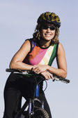 Female cyclist smiling for the camera — Stock Photo