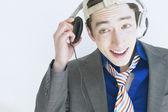 Man wearing headphones and listening to music — Stock Photo