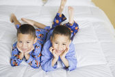 Portrait of African brothers on bed — Stock Photo