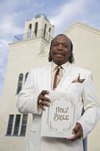 Senior African American man in front of church — Stock Photo